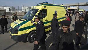 صورة من الأرشيف لقوات الأمن المصرية في مطار القاهرة بانتظار وصول سبعة مصريين وجدوا مقتولين قرب بنغازي في ليبيا 26 فبراير / شباط 2014