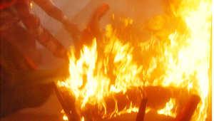 اثناء اشتعال النار في الضحية وضحيته