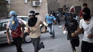 ملثمون في مظاهرة بالبحرين في 30 مايو/ أيار 2014
