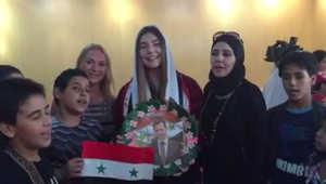 """من الاحتفال في عيد ميلاد الأسد إلى """"سيلفي"""" مع المفتي السوري بدرالدين حسون... من هي الجميلة الروسية التي اجتاحت الأراضي السورية؟"""