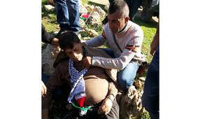 صورة زياد أبو عين لحظة إصابته كما نشرتها وكالة الأنباء الفلسطينية 10 ديسمبر/ كانون الاول 2014