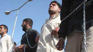 صورة أرشيفية لأشخاص يطالبون بالإفراج عن سجناء بالعراق