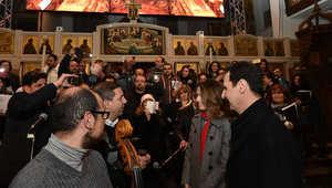 بالصور.. بشار وأسماء الأسد يزوران كنيسة بدمشق