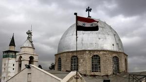 العلم السوري يظهر أمام قبة كنيسة القديس سركيس لللأرمن الأرثوذكس