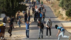 فلسطينيون من سلواد، شمال رام الله، يشتبكون مع قوات الأمن الإسرائيلية في أعقاب مسيرة في القرية