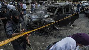 قوات الأمن المصرية في موقع الهجوم الذي استهدف موكب النائب العام المصري، هشام بركات، والذي أدى لوفاته