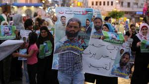 متظاهرون فلسطينيون يشاركون في مسيرة في مدينة رام الله تضامنا مع محمد علان