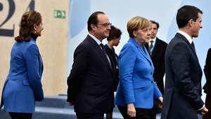 الرئيس الفرنسي فرنسوا هولاند والمستشارة الألمانية أنغيلا ميركل في قمة المناخ بباريس