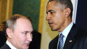 الرئيس الروسي فلاديمير بوتين والرئيس الأمريكي باراك أوباما على هامش مؤتمر الامم المتحدة حول تغير المناخ في باريس