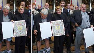 بالفيديو.. سقوط سروال رئيس لجنة هيلسنكي أمام رئيسة كرواتيا أثناء تكريمه
