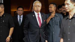 رئيس الوزراء الماليزي نجيب عبد الرزاق يتجه نحو سيارته بعد حضوره جلسة البرلمان في كوالالمبور يوم 26 يناير 2016
