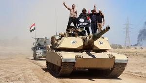 كارتر في بغداد بزيارة مفاجئة.. وفرقة مدرعة عراقية تتقدم لقراقوش