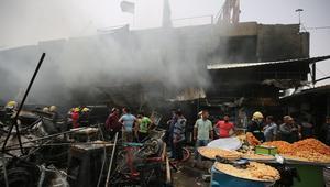 مقتل 22 شخصا وإصابة العشرات إثر تفجيرين انتحاريين في بغداد