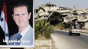 صورة أرشيفة لآثار القصف على حمص