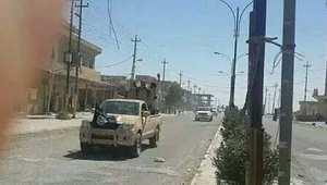 موكب سيارات تحمل عناصر من داعش في سنجار
