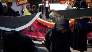 من مظاهرة في إندونيسيا احتجاجا على إعدام عاملة في السعودية.