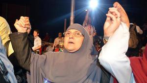 زوجي مرسي خلال مسيرة مؤيدة لزوجها