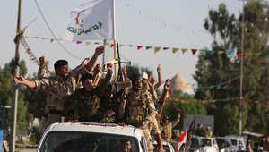 عناصر من كتيبة العباس باستعراض في كربلاء