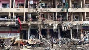 -آثار انفجار سيارة في بغداد يوم 8 يونيو/حزيران 2014
