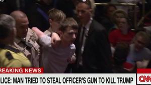 رجل يحاول سحب مسدس شرطي ليقتل دونالد ترامب