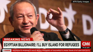 الملياردير المصري ساويرس يعرض شراء جزيرة من إيطاليا أو اليونان لإنقاذ لاجئي سوريا.. ويرد لـCNN على المشككين: لا يُعرف عني عدم الجدية