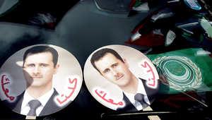 صور بشار الأسد فوق سيارات مناصريه في مظاهرة تأييد سابقة