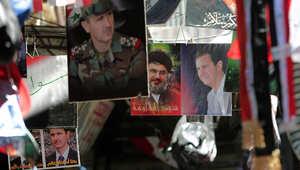 ملصقات للأسد في محل بدمشق