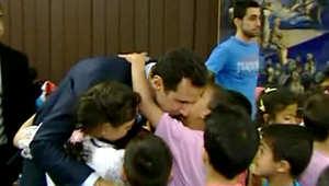 بشار الأسد وزوجته يلتقيان بالأيتام