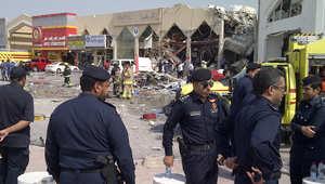 رجال أمن قطريون يتفقدون مسرح الانفجار الذي وقع في فبراير/شباط 2014