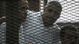 الصحفيون الثلاثة (من اليمين): باهر محمد، ومحمد فهمي، وبيتر غريست