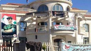 """القاسم يرد على صورة لمنزله """"المحتل"""" بسوريا محاط بصور الأسد: جبناء"""