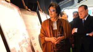 معمر القذافي وسلفيو برلسكوني في أحد اللقاءات السابقة