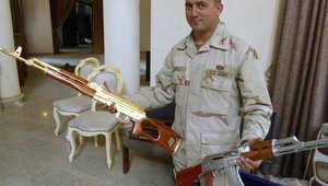 بالصور: الحكم على أمريكي اعترف بالتورط في بيع أسلحة مسروقة لصدام حسين وعائلته