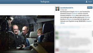 صورة ميركل مع الرئيسين الفرنسي فرانسوا هولاند والروسي فلاديمير بوتين