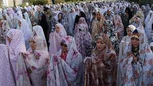 إيرانيات يؤدين صلاة العيد في طهران 2013