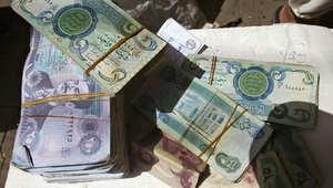 صورة أرشيفية لعملات نقدية عراقية تعود إلى عهد الرئيس العراقي الأسبق صدام حسين