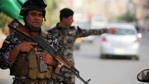قوات الأمن العراقية تحرس أحد الحواجز في بغداد
