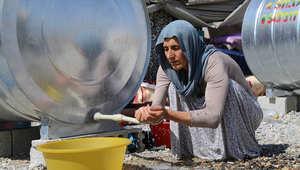 لاجئة عراقية في مخيم للاجئين على الحدود العراقية التركية