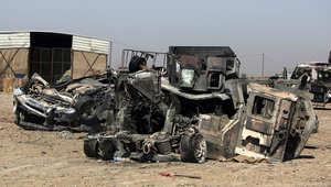 صورة أرشيفية لإحدى السيارات العسكرية العراقية المدمرة خلال المواجهات مع داعش