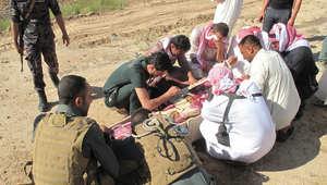 """مقبرة جماعية تضم 200 جثة لمقاتلين سُنة بالأنبار والعبادي يتوعد بالرد على جرائم """"داعش"""""""