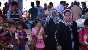 نساء وأطفال فروا من الموصل