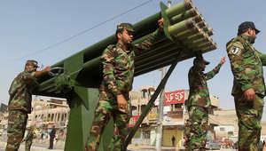 مقاتلون شيعة أثناء استعراض عسكري جرى ببغداد السبت