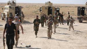 مجموعة من القوات الأمن العراقية بعد قتال عناصر داعش شمال العراق