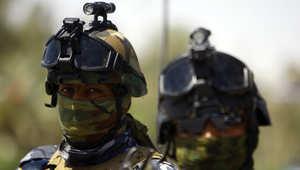 عناصر أمن عراقية ملثمة