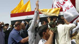 عراقيون في جنازة مقاتل شيعي سقط في سوريا