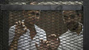 اثنان من صحفيي الجزيرة أثناء المحاكمة