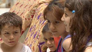 لاجئون سوريون يحولون مركزا تجاريا إلى بيوت لهم