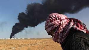 """اشتعال النيران بخزانات نفط ليبية إثر هجوم شنه """"داعش"""" على ميناءي السدرة وراس لانوف"""