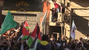 إحراق أعلام وتحطيم صور لترامب في تظاهرات الأردن