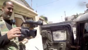 شاهدوا لحظة نجاة مصوّر عراقي من رصاصة قنّاص